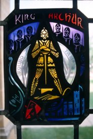 Stained glass, like this of King Arthur in the O'Shaughnessey-Frey library, are visible all over campus.