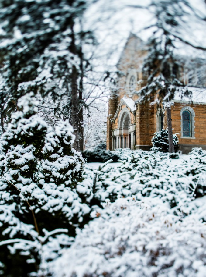 St. Mary's Chapel is seen through snow-covered trees.