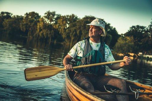 Neuzil paddles on Lake Nokomis.