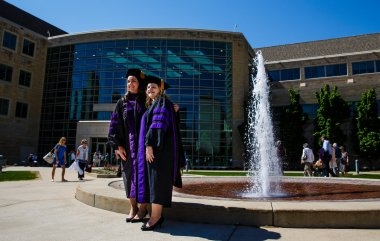 New School of Law graduates pose for a photo outside the School of Law building following the School of Law Commencement ceremony May 13, 2017.