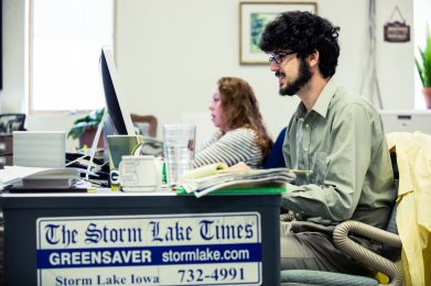 Art Cullen's son, Tom Cullen, a reporter, works on a story.