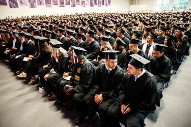 Students await the start of the 2017 Undergraduate Commencement ceremony in the Anderson Athletic and Recreation Complex in St. Paul on May 20, 2017.