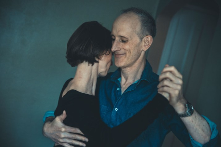 Spanish professor Michael Scham dances with his fiancee Clara Krug in their St. Paul home.