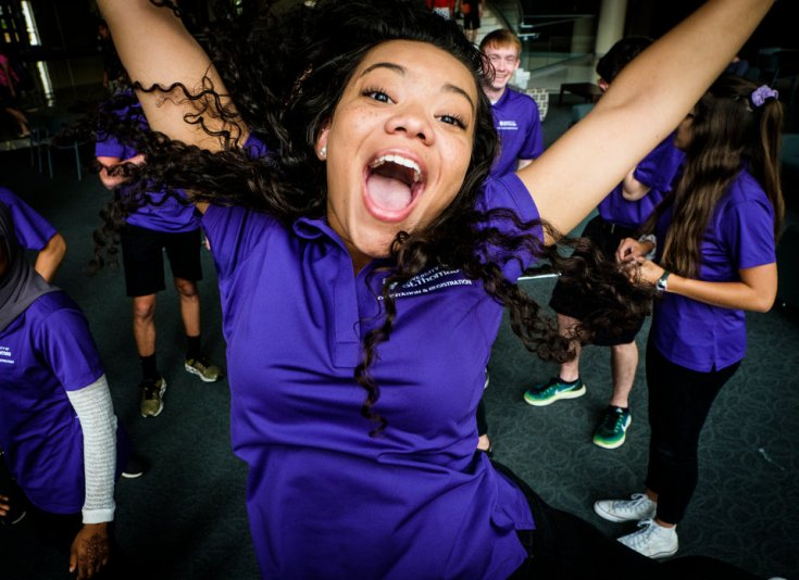 Orientation leader Kenzie Fannin plays to the camera after an orientation leader group photo June 28, 2017 in the Anderson Student Center.