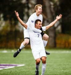 Christian Elliehausen celebrates a goal with teammate Pierce Erickson on his back during the MIAC Championship soccer game against Macalester on the south athletic fields on November 4, 2017 in St. Paul. The Tommies won 5-2.