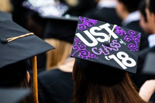 "A motarboard cap reads ""UST Class of '18"" during the 2018 Undergraduate Commencement ceremony in O'Shaughnessy Stadium on May 18, 2018 in St. Paul."