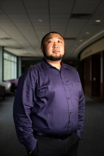 Portrait of MIC staff Ed Kim outside of the James B. Woulfe Alumni Hall in the Anderson Student Center during the Proud To Be First reception on Aug. 31, 2018.