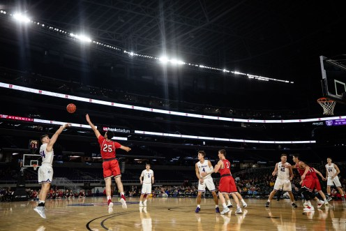 St. Thomas and UW-River Falls compete in the first-ever basketball game played at U.S. Bank Stadium.