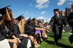 High-fives and smiles were plentiful during the undergraduate commencement ceremony.