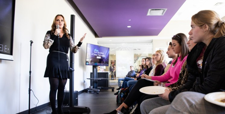"""Angelina Lawton, founder and CEO of Sportsdigita, speaks to a crowd of students who gathered in the Create Space at Anderson Student Center on October 16, 2018 as a part of the Schulze School of Entrepreneurship's """"Women Entrepreneurship Week""""."""