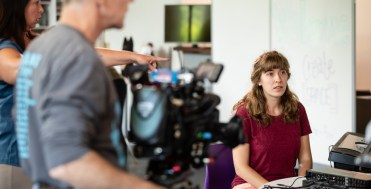 "Emily Meuer '18, participates in a Twin Cities Public Television (TPT) filming of a ""Sci Girls"" episode in the create space in the Anderson Student Center on July 23, 2018 in St. Paul."