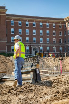 Jim Brummer, AVP for facilities, looks over construction work on the Iversen Center for Faith and first-year residence hall construction projects near Ireland Hall on July 11, 2019, in St. Paul. (Mark Brown/University of St. Thomas)