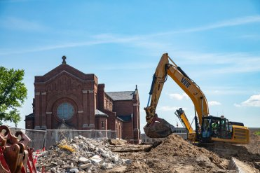 Construction crews work on the Iversen Center for Faith construction project near Chapel of St. Thomas Aquinas on July 11, 2019, in St. Paul. (Mark Brown/University of St. Thomas)