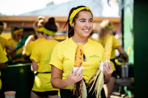 A worker holds corn for customers at the Corn Roast stand at the Minnesota State Fair.
