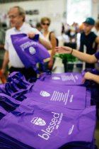 Volunteers hand out purple bags at the Minnesota State Fair on August 22, 2019 in St. Paul.
