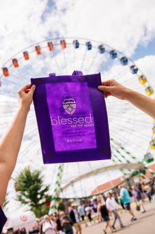 The St. Thomas purple bag in front of the ferris wheel at the Minnesota State Fair.