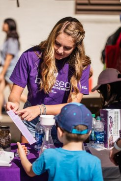 Biochemistry major Sarah Shadle speaks to a young fairgoer on STEM day at the Minnesota State Fair on August 22, 2019 in St. Paul.