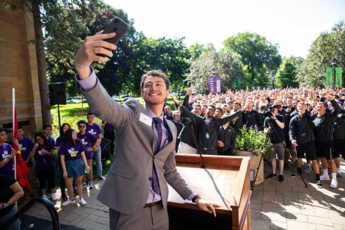 Student government president Logan Monahan takes a selfie during the annual March through the Arches to celebrate the start of the school year and the arrival of a new class of freshmen on campus on September 3, 2019, in St. Paul.
