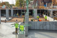 Crews work on the cement pad on the first year residence hall construction project on north campus on October 18, 2019, in St. Paul.