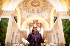 Victoria Young, Professor and Chair of Art History, speaks to members of the University of St. Thomas' board of trustees, campus ministry, and lead donors about the renovations made to the Chapel of St. Thomas Aquinas following a construction site hard-hat tour of the Iverson Center for Faith on the St. Paul campus on November 13, 2019.
