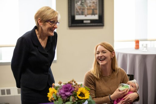 President Julie Sullivan talks with Social Work Professor Tonya Horn during a celebration of the naming of the Morrison Family College of Health in the Iversen Hearth Room. Mark Brown/University of St. Thomas