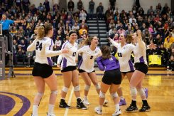 The volleyball team celebrates winning the MIAC Championship against St. Olaf in the Anderson Athletic and Recreation Center. Mark Brown/University of St. Thomas