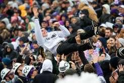 St. Thomas Football fans celebrate a touchdown. Liam James Doyle/University of St. Thomas