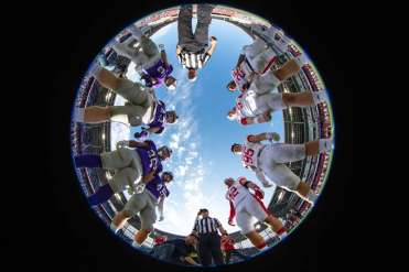 Tommies and Johnnies meet at the center of the field for the coin toss during the 2019 Tommie Johnnie football game at Allianz Field. Mark Brown/University of St. Thomas