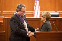 President Julie Sullivan congratulates School of Law Professor Jerry Organ during his investiture ceremony. Liam James Doyle/University of St. Thomas