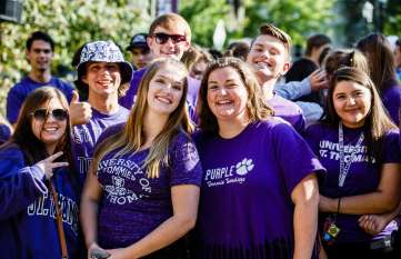 Freshmen, including Zoe Robinson (center right) pose for the camera before the March Through the Arches event September 8, 2016.