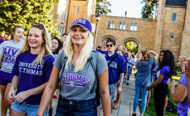 Students, including Tatum Manning (left) and Montanna Edling smile during the March Through the Arches September 8, 2016.