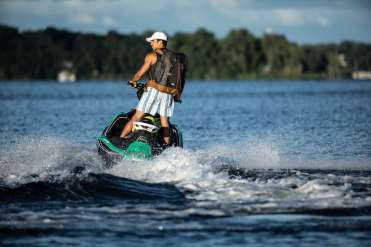 Schulze Innovation Scholar Dylan Dierking founded Foodski, a jet ski food delivery business based in White Bear Lake. Dierking takes orders for deliveries from customers ordering food from area restaurants and delivers them to homes and boats around the lake on his jet ski. Photos taken on July 22, 2020, in White Bear Lake. Dylan Dierking makes a delivery via Jet
