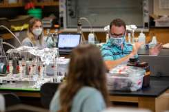 Professor Kyle Zimmer teaches an environmental studies class in Owens Science Hall. Mark Brown/University of St. Thomas