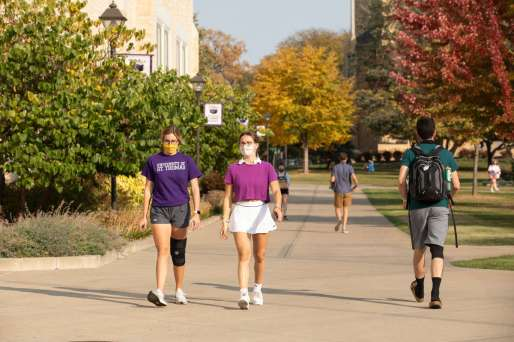 Students walk through the lower quad on a beautiful fall afternoon during Homecoming week. Mark Brown/University of St. Thomas