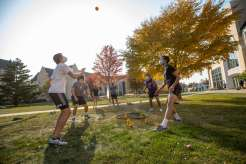 Students play spike ball on the lower quad on a beautiful fall afternoon during Homecoming week. Mark Brown/University of St. Thomas