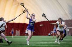 Kelly Coyne takes a shot on goal during a Women's Lacrosse Game against the University of Minnesota at the UMN Sports Dome on February 22, 2020. This is the last sports event I photographed in 2020.