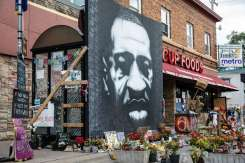 A mural commemorating George Floyd at the site of his murder outside Cup Foods at the intersection of 38th and Chicago Avenue. The mural was created by artist Peyton Scott Russell. Mark Brown/University of St. Thomas