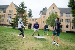 Students play Spike Ball outside on the lower quad of the St. Paul campus. Liam James Doyle/University of St. Thomas