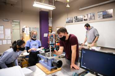 Students in Dr. Travis Welt's Soil Mechanics and Foundations lab wear masks while working together. Liam James Doyle/University of St. Thomas