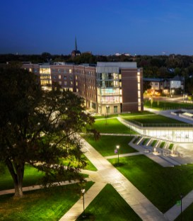 A wide view of the upper quad featuring the Iversen Center for Faith, the Chapel of St. Thomas Aquinas and Tommie North Residence Hall as photographed at dusk on the rooftop of Brady Hall in St. Paul on Sept. 29, 2020.