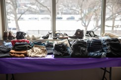 Donated clothing sits on a table at Tommie's Closet. Mark Brown/University of St. Thomas