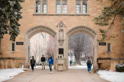 Students walk through The Arches after a snowfall. Mark Brown/University of St. Thomas