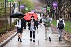 Students walk across campus on a rainy spring day. Mark Brown/University of St. Thomas