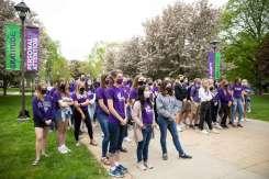Freshman students listen to university president Julie Sullivan speak.