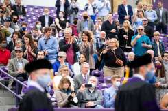 Family and friends cheers for students from the School of Law's Class of 2020. Liam James Doyle/University of St. Thomas