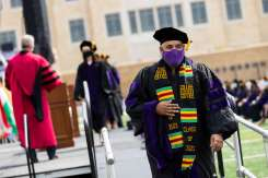 A student walks off the stage after receiving his degree during the School of Law 2021 Commencement Ceremony. Mark Brown/University of St. Thomas