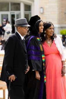 A student poses for a photo with family members after the School of Law Class of 2021 Commencement Ceremony. Mark Brown/University of St. Thomas