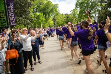 People cheer as students walk toward Summit Avenue during the annual March Out of the Arches event. Mark Brown/University of St. Thomas