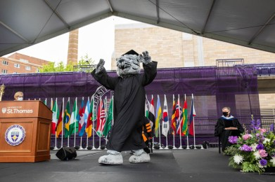 Tommie the mascot walks across stage. Mark Brown/University of St. Thomas