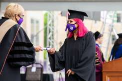 Students receive their diplomas during the Dougherty Family College commencement ceremony. Liam James Doyle/University of St. Thomas